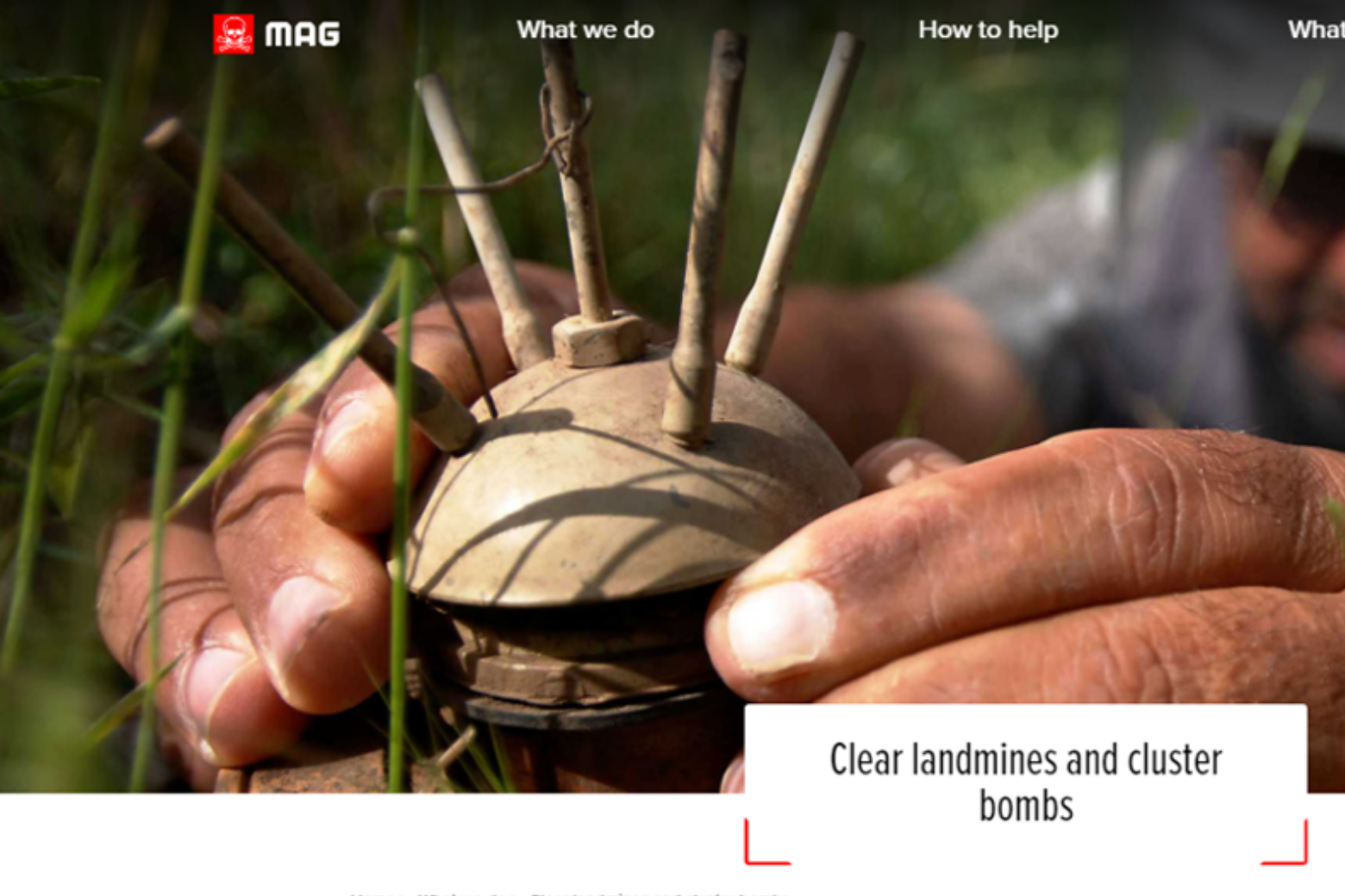 Man carefully holding landmine